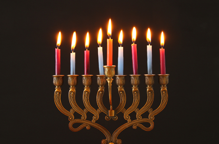 Image of Jewish holiday Hanukkah background with menorah (traditional candelabra) and candles 스톡 콘텐츠