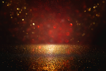 Red, black and gold glitter lights background. defocused Stock Photo