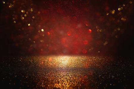Red, black and gold glitter lights background. defocused Banque d'images