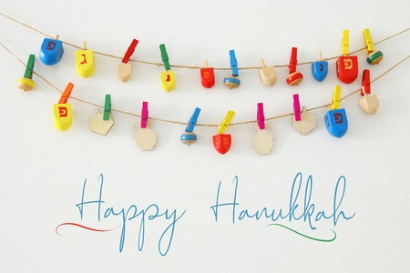 Image of jewish holiday Hanukkah with wooden dreidels colection (spinning top) over white background Stock Photo