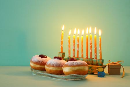 image of jewish holiday Hanukkah background with menorah (traditional candelabra). Selective focus Stock Photo