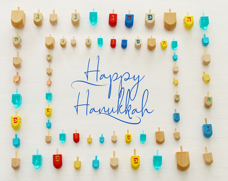 Image of jewish holiday Hanukkah with wooden dreidels colection (spinning top) over white background Archivio Fotografico
