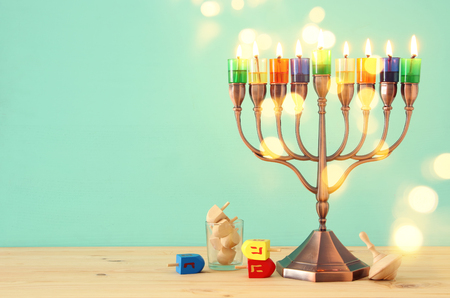 image of jewish holiday Hanukkah background with menorah (traditional candelabra) and colorful candles Stock Photo