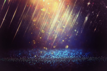 glitter vintage lights background. black, blue and gold. de-focused 免版税图像
