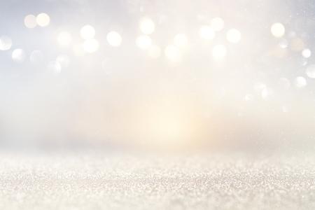 glitter vintage lights background. silver and light gold de-focused