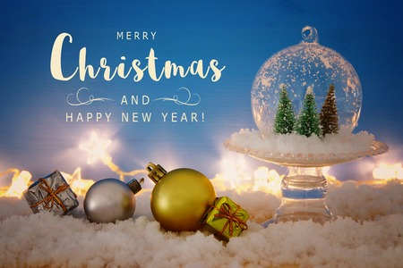 Christmas image of christmas trees inside glass ball over wooden table