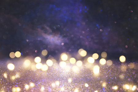 glitter vintage lights background. silver, black, purple and gold. de-focused 免版税图像