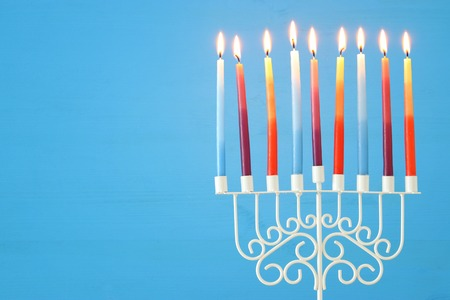 image of jewish holiday Hanukkah background with menorah (traditional candelabra) and colorful candles Stock fotó