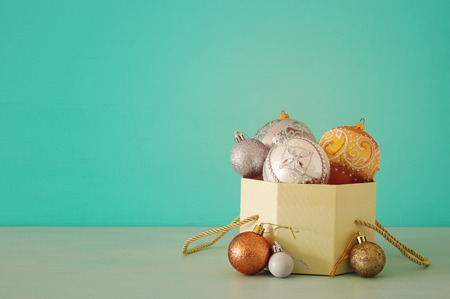 Image of christmas festive tree gold, silver and white balls decoration in the gift box