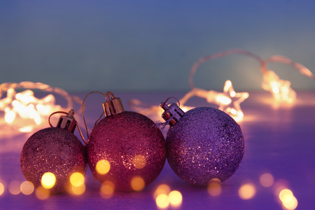Image of christmas festive tree gold, purple and violet balls decoration