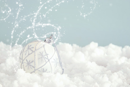 Image of christmas festive tree white ball decoration in front of pastel blue background background
