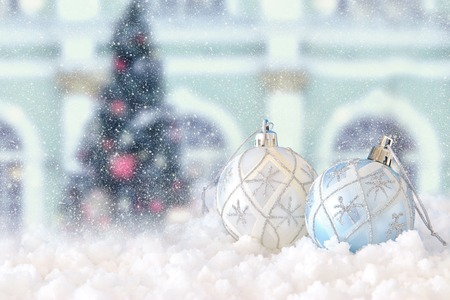 Image of Christmas festive tree white ball decoration in front of magical winter landscape background