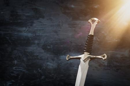low key image of silver sword. fantasy medieval period
