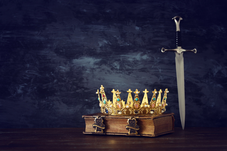 low key image of beautiful queenking crown and sword. fantasy medieval period Stock Photo