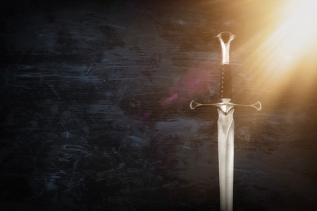 low key image of silver sword. fantasy medieval period