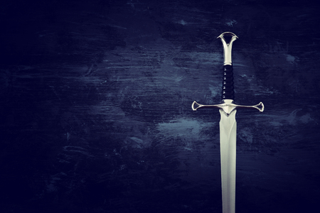 Low key image of silver sword. Fantasy medieval period Stock Photo