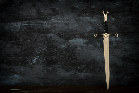 Low key banner of silver sword. Fantasy medieval period
