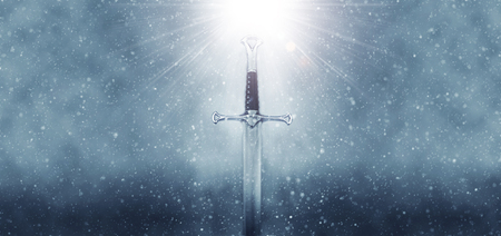 Mysterious and magical photo of silver sword over Gothic snowy black background. Medieval period concept Banque d'images