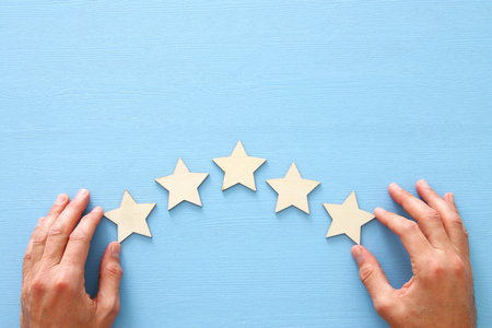 Concept of setting a five star goal. Increase rating or ranking, evaluation and classification idea.