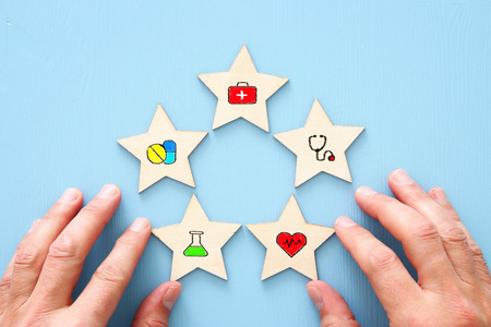 Setting a five star medical service goal.  Healthcare and insurance concept.
