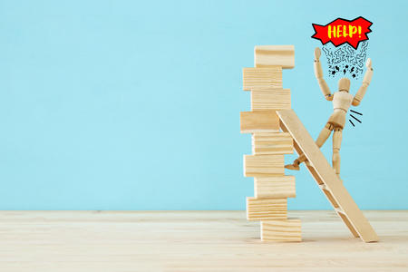 wooden dummy climbs a dangerously unstable structure and risks falling Stock Photo - 114636700