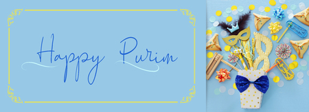 Purim celebration concept (Jewish carnival holiday) over blue wooden background. Top view Stock Photo