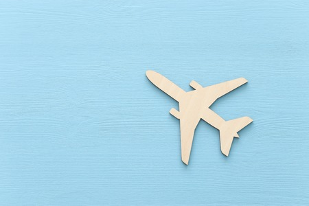 Top view photo of wooden airplane over blue background Banco de Imagens