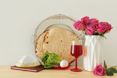 Pesah celebration concept (jewish Passover holiday) over wooden table