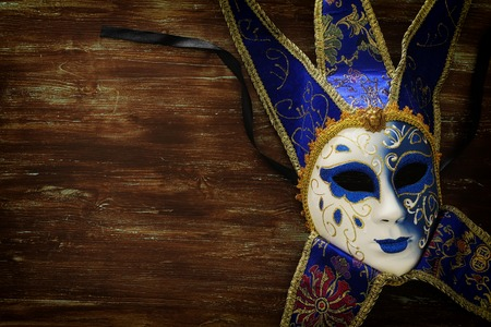 Blue with gold elegant traditional Venetian mask over dark background