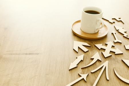 coffee cup over wooden table . top view