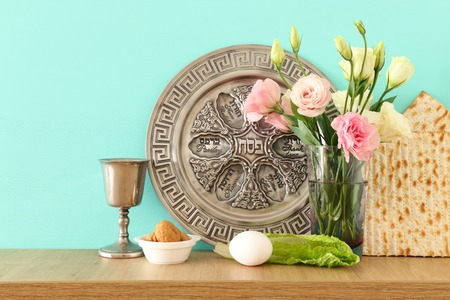 Pesah celebration concept (jewish Passover holiday). Translation for Hebrew Text over plate: (PESAH) PASSOVER Stock Photo