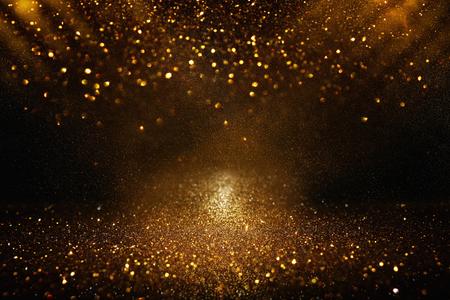 Fond de lumières vintage de paillettes. Noir et or. Défocalisé Banque d'images