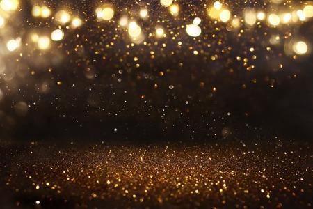 Glitter Vintage Lichter Hintergrund. Schwarz und Gold. Defokussiert