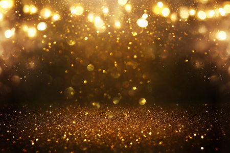 Glitter vintage lights background. Black and gold. De-focused Stock fotó