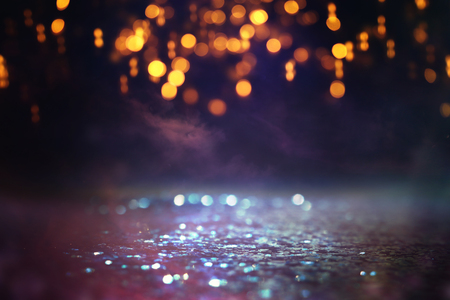 glitter vintage lights background. black, purple, blue and gold. de-focused 免版税图像