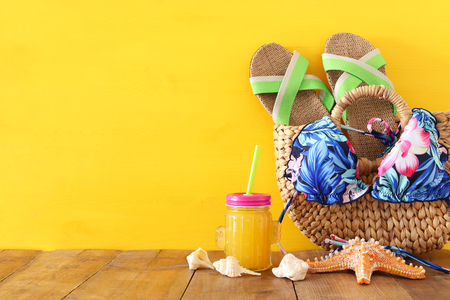 vacation and summer concept with sea life style objects and fresh fruit drink over wooden table 版權商用圖片