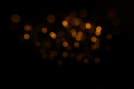 Glitter vintage lights background. Black and gold. De-focused 免版税图像