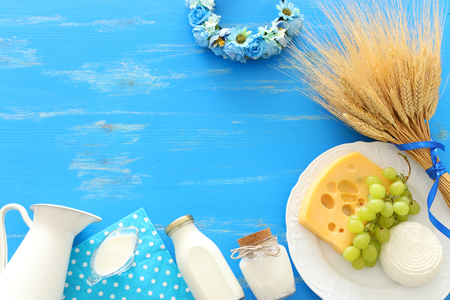 Top view photo of dairy products over blue wooden background. Symbols of Jewish holiday - Shavuot Banque d'images
