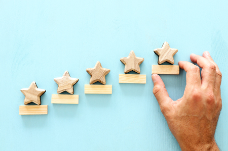 Concept of setting a five star goal. Increase rating or ranking, evaluation and classification idea