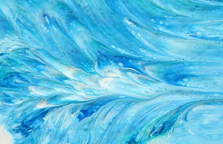 photography of abstract marbleized effect background. Blue, mint and white creative colors. Beautiful paint