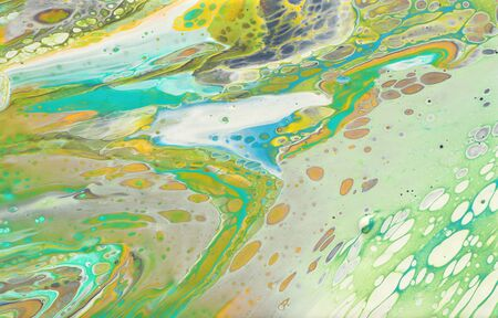photography of abstract marbleized effect background. yellow, green and white creative colors. Beautiful paint Reklamní fotografie