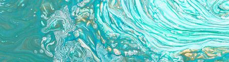 Photography of abstract marbleized effect background. Blue, mint, gold and white creative colors. Beautiful paint. Banner