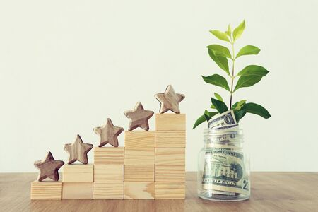 Business concept image of setting a five star goal. Increase rating or ranking, evaluation, money investment and financial growth concept 免版税图像 - 127021043