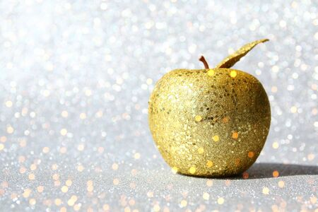 Rosh hashanah (Jewish New Year holiday) concept. Traditional symbol, decorative glitter gold apple