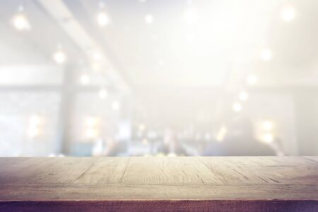 background Image of wooden table in front of abstract blurred lights