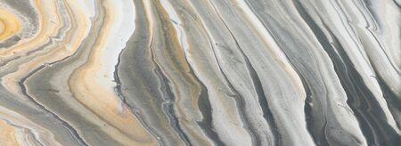 Fotografie des abstrakten marmorierten Effekthintergrundes. Kreative Farben schwarz, grau, gold und weiß. Banner
