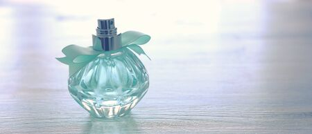 beauty/fashion Image of elegant perfume bottle over pastel background. vintage filtered image