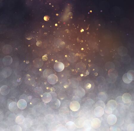 blackground of abstract glitter lights. blue, gold and black. de focused