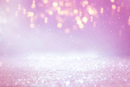 background of abstract glitter lights. purple, pink, gold and silver. de focused