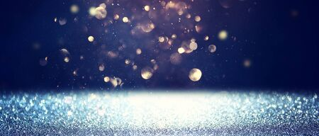 blackground of abstract glitter lights. blue, gold and black. de focused. banner Stock Photo - 128865954